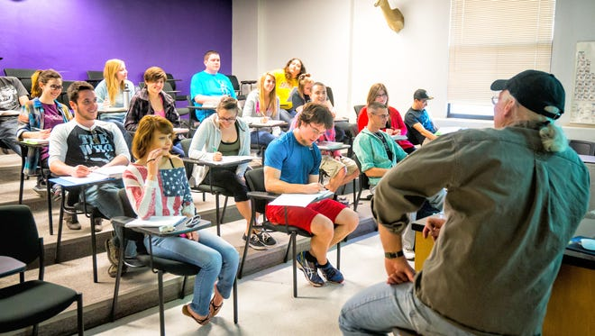 Western New Mexico University students, at least 85 percent of which draw on financial aid to attend WNMU, are pictured in class.