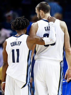 Memphis Grizzlies teammates Mike Conley, left, and Marc Gasol hug after a victory against the Dallas Mavericks at the FedExForum in Memphis on Oct. 26, 2017.