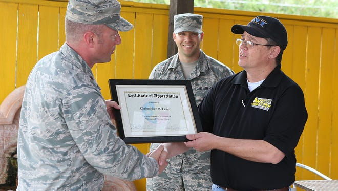 Major Ken Zimmerman (left), director of operations for the 316th at Goodfellow Air Force Base and SSgt. Justin Clemons present Christopher McLester, general manager at Which Wich, with a Challenge Coin and a certificate of appreciation Tuesday, August 8, 2017.