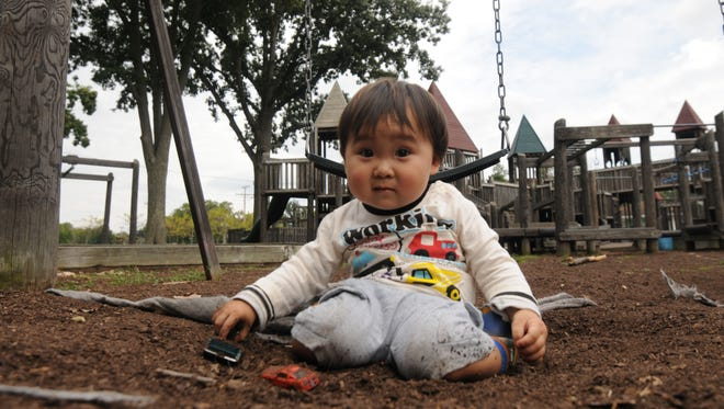 Kou Saito plays in the dirt with his cars Tuesday afternoon at Aumiller Park.