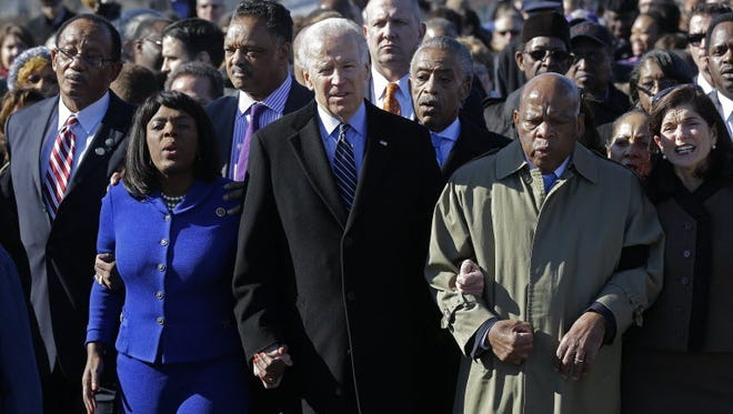 Vice President Biden, center, leads a group across the Edmund Pettus Bridge in Selma, Ala., on March 3, 2013. From left: Selma Mayor George Evans, Rep. Terri Sewell, D-Ala., the Rev. Jesse Jackson, Biden, the Rev. Al Sharpton and Rep. John Lewis, D-Ga.