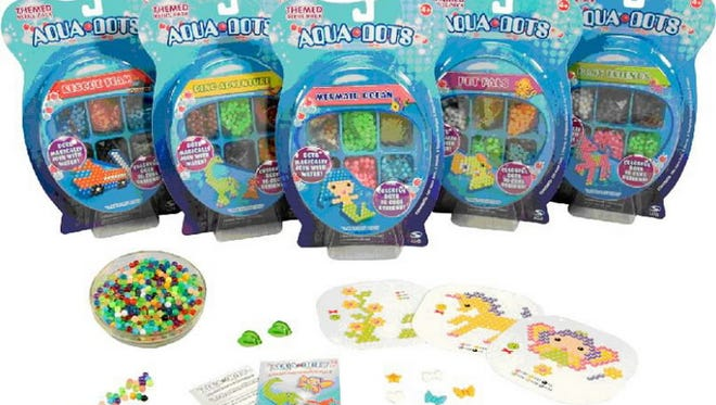 This undated handout photo provided by the Consumer Product Safety Commission  shows Aqua Dots, a Chinese-made toy recalled Wednesday, Nov. 7, 2007, by the Consumer Product Safety Commission.