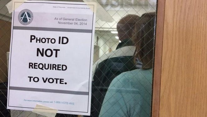 A sign for voters at the St. Francis Xavier Parish community center in De Pere on Tuesday morning, Nov. 4, 2014.