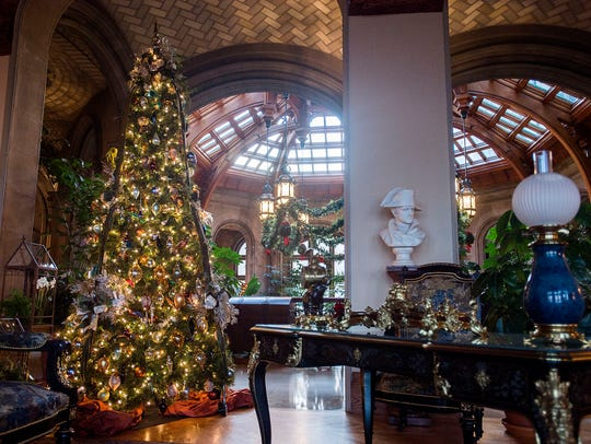 The 250-room Biltmore House once again is decorated for the holiday season, with over 50 Christmas trees and thousands of lights.