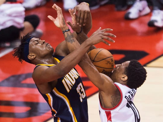 Toronto Raptors guard DeMar DeRozan (10) battles for the ball against Indiana Pacers forward Myles Turner (33) during Game 7 of round one NBA playoff basketball action in Toronto on Sunday, May 1, 2016. (Nathan Denette/The Canadian Press via AP)