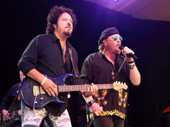 Steve Lukather, left, and Joseph Williams of the band Toto perform in concert at Pier Six Pavilion on Wednesday, Aug. 12, 2015, in Baltimore. (Photo by Owen Sweeney/Invision/AP)