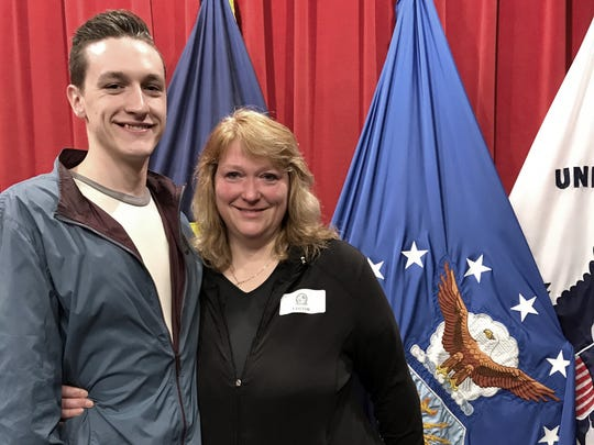Kirk and Deanna Ervin of Lapeer at his Air Force swearing-in ceremony in April 2017.