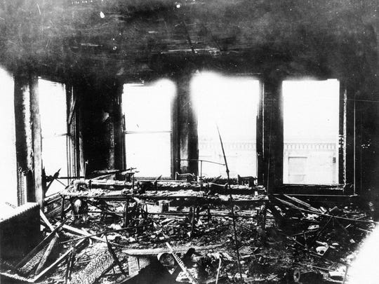 This 1911 file photo shows the burned-out remains of