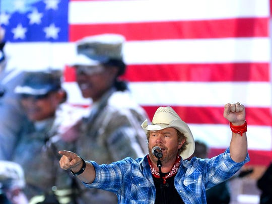 Toby Keith performs onstage during ACM Presents: An All-Star Salute to the Troops in Las Vegas in 2014.