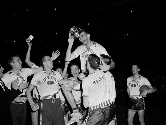 Louisville's Charlie Tyra, carried by his happy teammates, places the NIT's most valuable player award on his head after presentation at New York's Madison Square Garden, March 24, 1956.