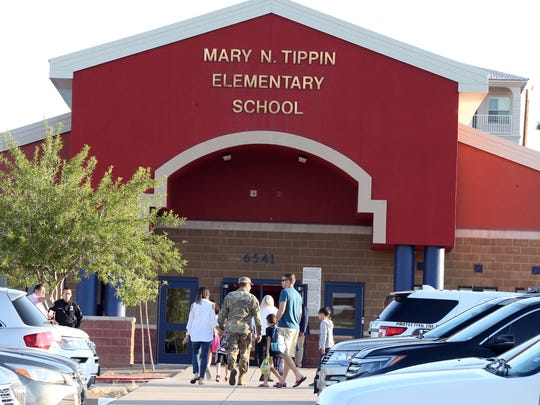 Parents drop off their children at Tippin Elementary School on Tuesday morning. A mother was killed in the West El Paso campus' parking lot on the first day of school after getting between three children and a car. The children also were injured.
