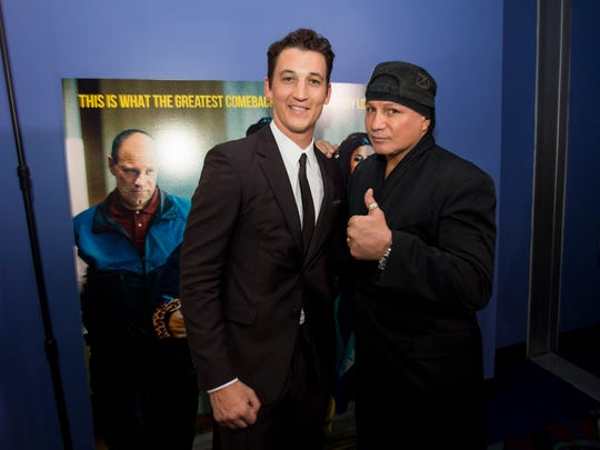 """Miles Teller (left) with Vinny """"The Pazmanian Devil"""" Paz, who he plays in the movie """"Bleed For This,"""" on November 10, 2016 in Providence, Rhode Island."""