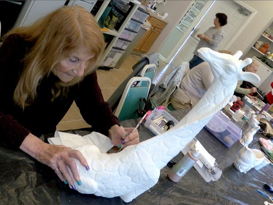 Toni Ann DiRienzo, 74, paints a ceramic giraffe in her Lakewood community's art class Thursday, February 15, 2018.  She has survived a total of 5 heart attacks, 2 open heart surgeries and is living with a leaky valve - but maintains a fairly normal life.