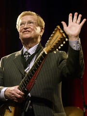 Harold Bradley waves in thanks to the crowd after playing
