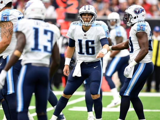 Titans quarterback Matt Cassel (16) calls a play before