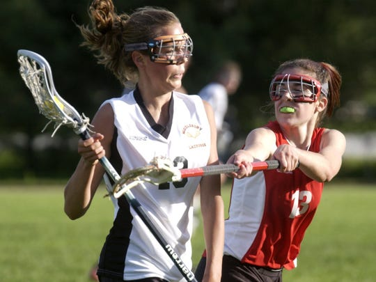 Sarah Dalton (left), seen here in the 2004 Division I high school girls lacrosse state championship game,  has been hired as UVM's next head coach for women's lacrosse.