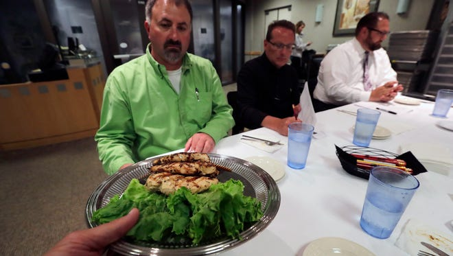 Chicken is served to a panel of judges during the USA TODAY NETWORK-Wisconsin BBQ Chicken Recipe Contest.