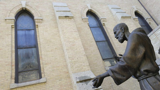 A statue of Solanus Casey, a Catholic priest who died decades ago, in the garden area of St. Joseph Catholic Church Monday, November 13, 2017, in Appleton, Wis. Casey is one step away from considered a saint. Dan Powers/USA TODAY NETWORK-Wisconsin