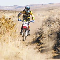 A dirt bike rider cruises a trail in Lyon County in 2010. If a bill in the 2015 Nevada Legislature becomes law many riders would no longer be required to register their off-road vehicles with the state.