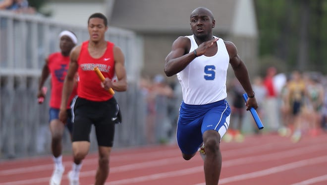 Salem's Bishon Patrick (right) races against Kensington Conference opponents during a relay Friday night.