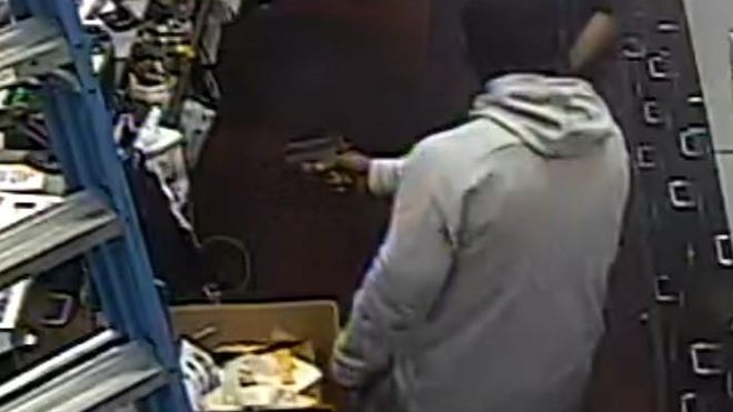 This surveillance camera image shows a gunman robbing the Game Stop at 3955 W. Broad St. on July 21.