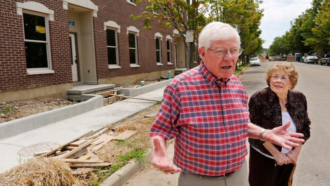 Michael and Phyllis Hunt talk about the development of the Centennial Townhomes Friday, July 28, 2017, at N. Sixth and Cincinnati streets in Lafayette. The couple are long-time residents of the Centennial Neighborhood.