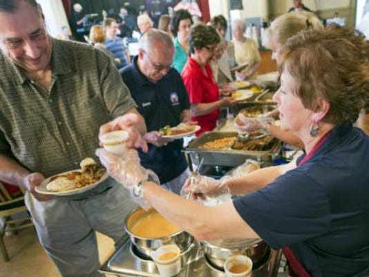 Marilyn Hake, right, of York, serves up soup to Wayne Kiser, on Manheim Township, Lancaster Co., who served in the National Guard during Vietnam. Hake began cooking yesterday for the luncheon that was prepared in house.