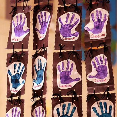Thousands of paper cutouts of children's hands are annually displayed in the capitol during Children's Week.