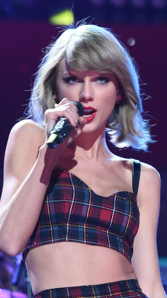 Taylor Swift performs onstage during iHeartRadio Jingle Ball 2014 in New York city.