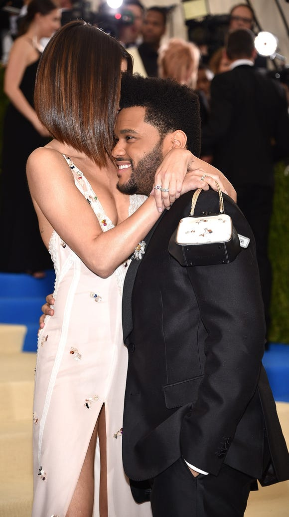 Selena Gomez and The Weeknd were all over each other