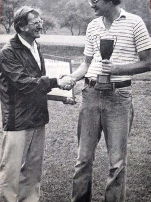 Wayne Noponen, right, receives the Delay Memorial trophy from Phil Delay after winning the 1982 Delay Memorial Tournament at Gardner Municpal Golf Course.