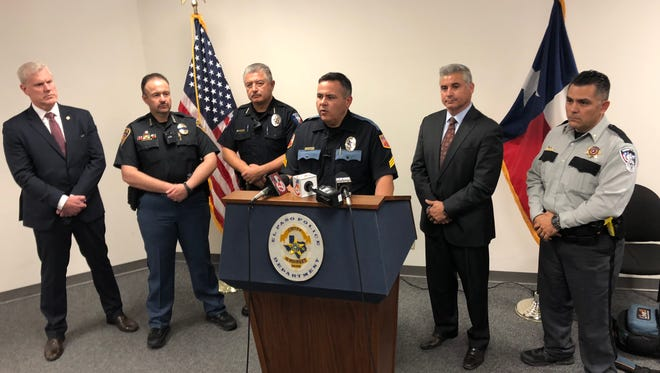 Police spokesman Sgt. Robert Gomez speaks about recent threats to area high schools while at the podium Monday at El Paso Police Department Headquarters as Ysleta Independent School District Superintendent Xavier De La Torre stands to his left with other area law enforcement agents.