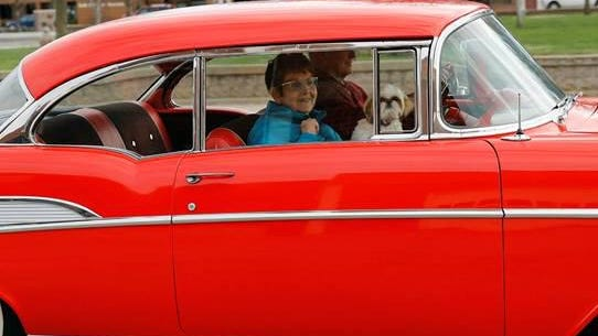 Jerry and Kay Kinnamon (retired teachers from St. John) drag Main Street in a red 1957 Chevy.  Kay's dog (Izzy) was also along for the ride.