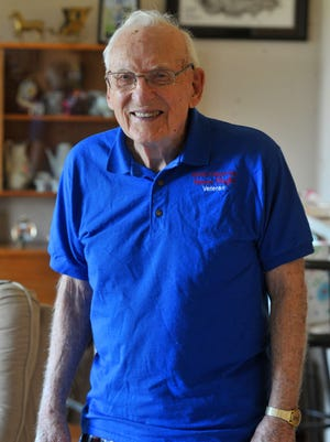 Ralph Buechler poses for a photo in his house at Primrose Assisted Living Facility in Wausau.