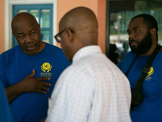 Dr. Rey Agard and his son Richard Agard talk to Roger Stephen head of the Seventh Day Adventist church who tries to help the Delaware Medical Team with their transportation to the island of Dominica from the Ferry Terminal at St. Lucia.