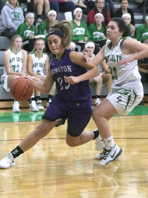 Lexington's Gabby Stover drives to the hoop during Tuesday's victory over Clear Fork.