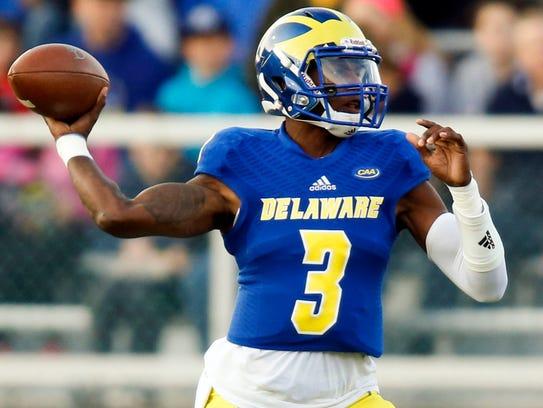 Delaware quarterback Joe Walker throws in the first