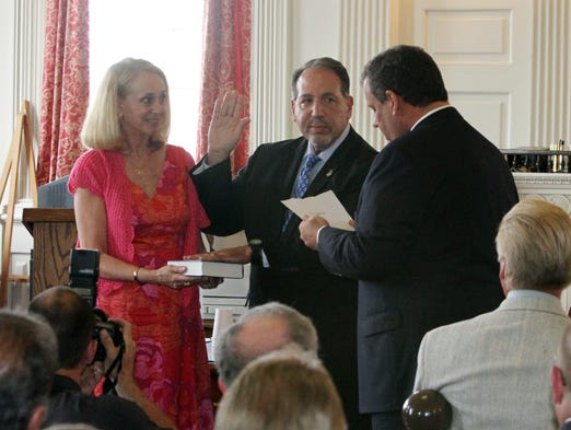 The swearing in ceremony for Morris County Prosecutor Fredric M. Knapp was held at the historic Morris County Courthouse in Morristown where New Jersey Governor Chris Christie was on hand for the administration of the Oath of office.  Here Governor Chris Christie (right) administrates the Oath of Office to Knapp (center) while his wife Ellie (left) hold the Bible.   On Wednesday July 2, 2014 Photo: Mark R. Sullivan/Staff Photographer