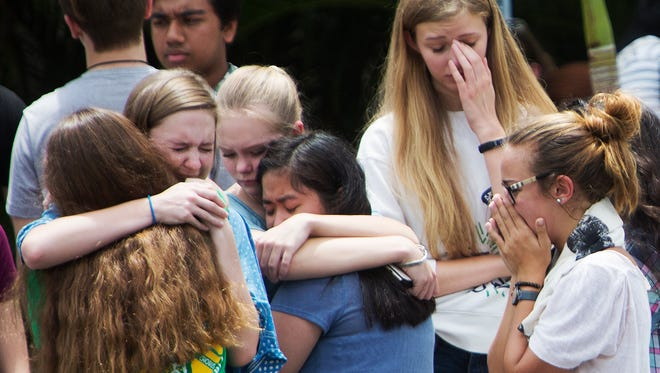 Mourners including Fort Myers High School students gathered at a Gift of Life ceremony at Lee Memorial Hospital for Cameron Mayhew,16, on Friday.  Mayhew was killed by driver while walking to his school bus.