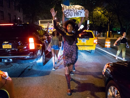 Protesters march along 5th Ave. in the Manhattan borough of New York Thursday, July 7, 2016, in the wake of the shooting deaths of Philando Castile Wednesday night in Falcon Heights, Minn. after a traffic stop by St. Anthony police, and the death of Alton Sterling, who was shot by Baton Rouge police in Baton Rouge, La., while being detained earlier this week.