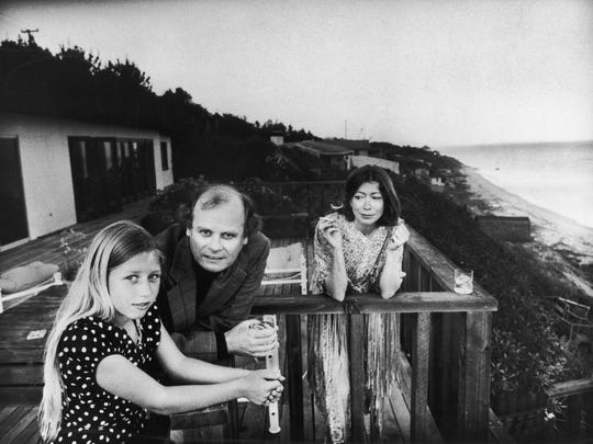 Joan Didion, right, pictured with husband John Gregory