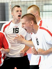 Dover's Brendan Warren (8) and Ryan Lamparter celebrate after winning the second game against Bethlehem Catholic in the PIAA Class AA boys' volleyball semifinals Saturday.