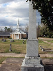 A marker in a cemetery near the First Baptist Church