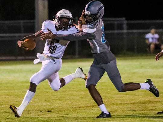 ELCHSÕs Jamaris Lee looks to stop Riverdale's Raekwon Clark as he gains yards. Riverdale at East Lee Football Monday, October 2nd, 2017.