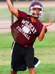 Cameron Sheppard throws a pass Tuesday morning at Tularosa