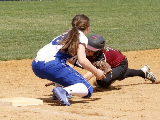 Sarah Coon of Elmira is tagged out at third base by Jill Murray of Horseheads on Wednesday during the Blue Raiders' 5-4 victory.