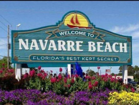 """The original """"Welcome to Navarre Beach"""" sign at the"""