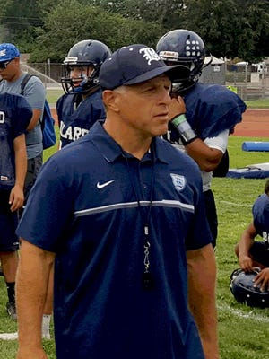Bullard High School head football coach Don Arax, like many athletic coaches in central California, schedules practices at night to avoid peak air pollution. It's not unusual to find fields littered with asthma inhalers.