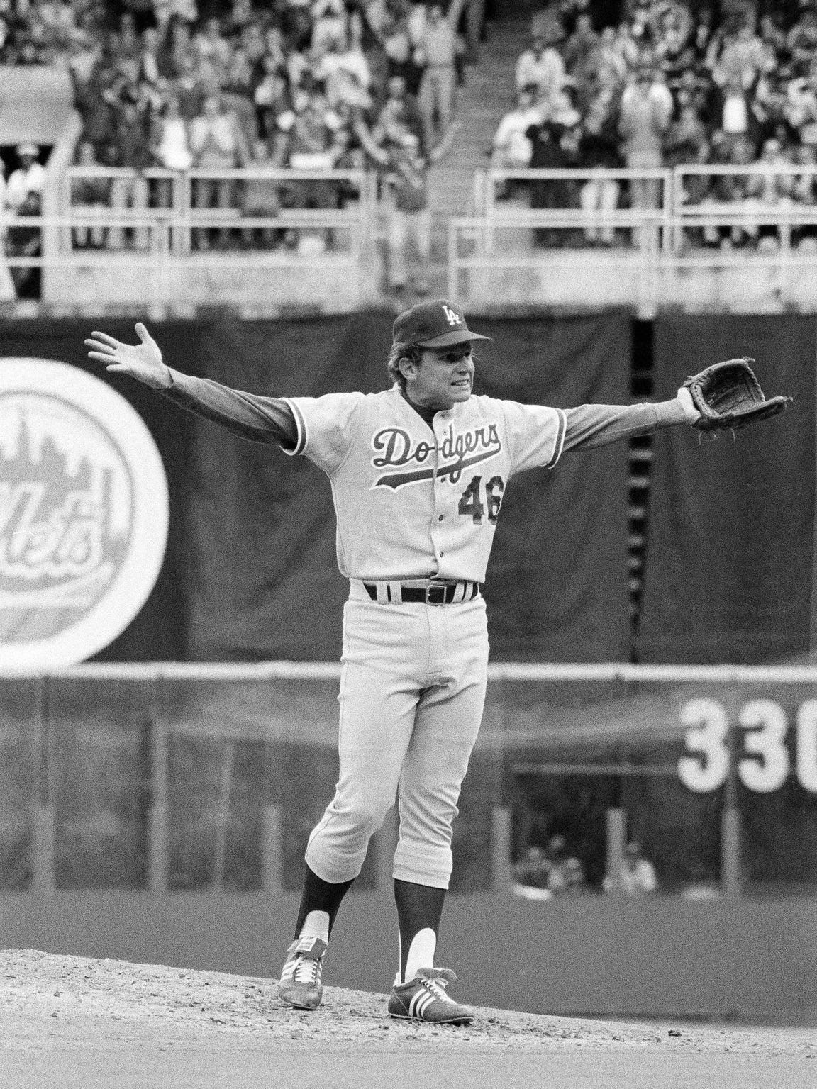 "Los Angeles Dodgers' pitcher Burt Hooton throws up his hands as if to say ""Now what?"" after he walked in the third Phillie run during the third National League playoff game in Philadelphia, Oct. 7, 1977. Dodgers manager Tom Lasorda took him out of the game. (AP Photo)"