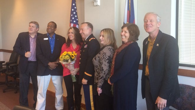 Retired U.S. Army Col. Terry Gilbert, center, will serve as the Larimer County Veterans Services Officer, replacing interim VSO Gael Shellhaas, who is holding flowers.